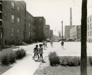 Lorch, Emil. Children Playing outside of Brewster Projects. 1930. Bentley Historical Library, University of Michigan. http://michiganradio.org/post/here-s-why-brewster-douglass-housing-projects-were-built-1930s