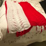 A red and white striped blanket my great-grandmother made