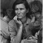 Black and white photo of a mother and her children.