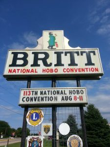 "Photo of the Britt town sign which states ""Britt, National Hobo Convention"""