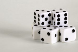Five dice with two stacked on top of the other three.